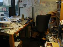 Photograph of an extremely cluttered office.