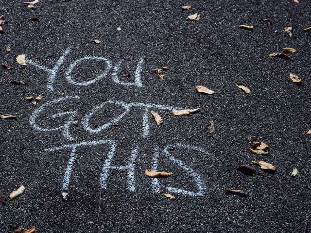 writing on road that says You Got This
